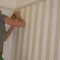 painting stripes on the wall